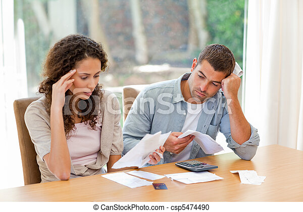 Young couple calculating their domestic bills - csp5474490