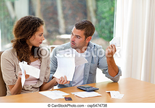 Young couple calculating their domestic bills - csp5474738
