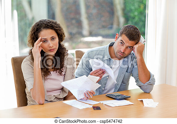Young couple calculating their domestic bills - csp5474742