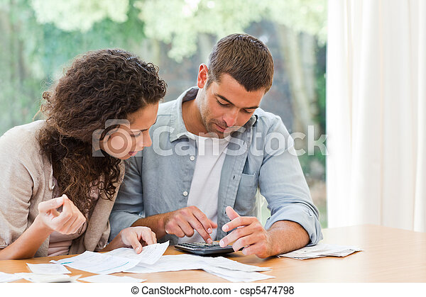 Young couple calculating their domestic bills - csp5474798