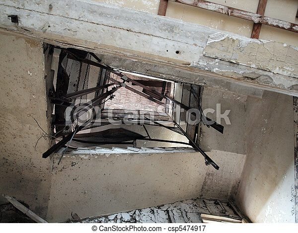 Looking up at a falling apart staircase - csp5474917
