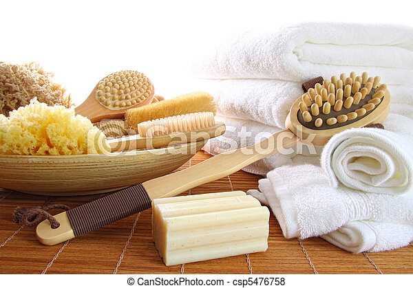 Spa still life of assorted bath brushes and sponges, soap towels on white - csp5476758