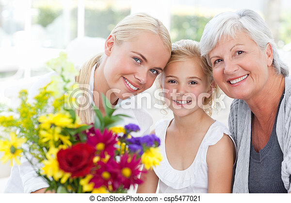 Radiant family with flowers  - csp5477021
