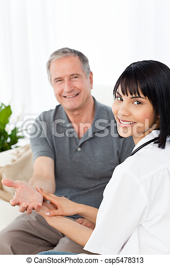 Nurse taking the pulse of  her patient - csp5478313