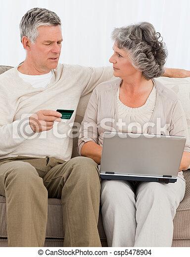 Seniors buying something on internet - csp5478904