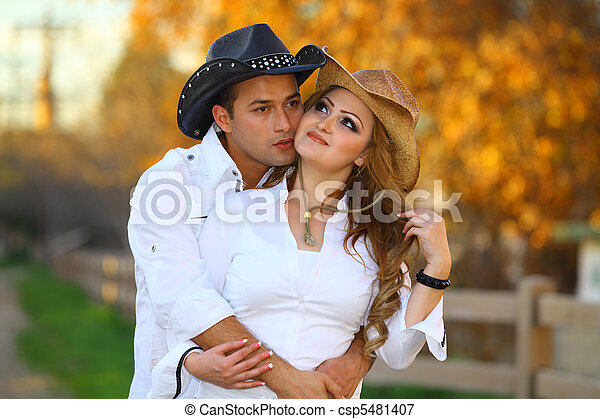 Cowboy and Cowgirl kissing - csp5481407