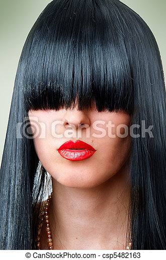 fashion woman with seductive red lips and bang - csp5482163