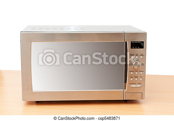 Microwave oven on the table - csp5483871