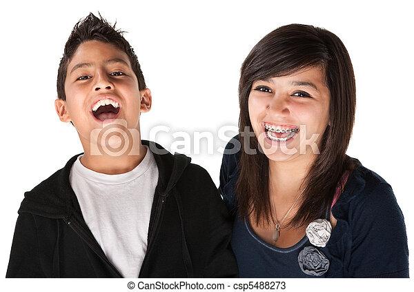 Two Smiling Siblings - csp5488273