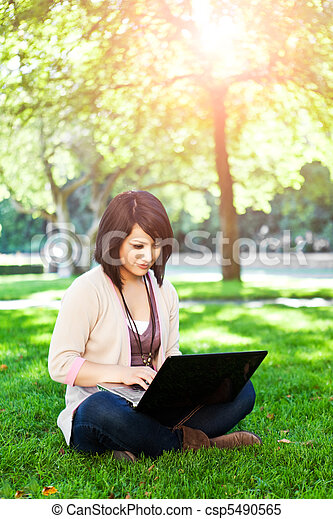 Mixed race college student with laptop - csp5490565
