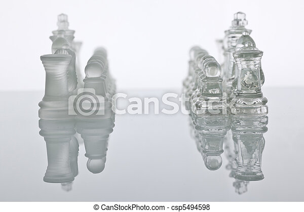 Glass chess on a glass countertop - csp5494598