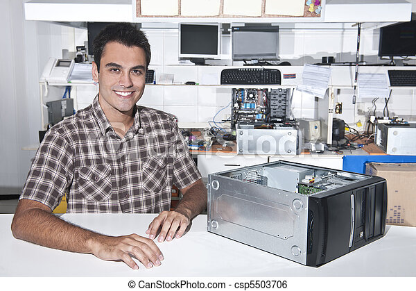 Happy owner of a computer repair store - csp5503706