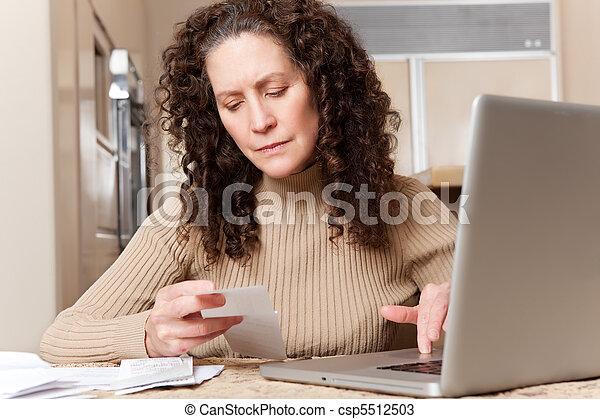 Woman paying bills - csp5512503