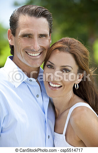 Successful Happy Middle Aged Man and Woman Couple Outside - csp5514717