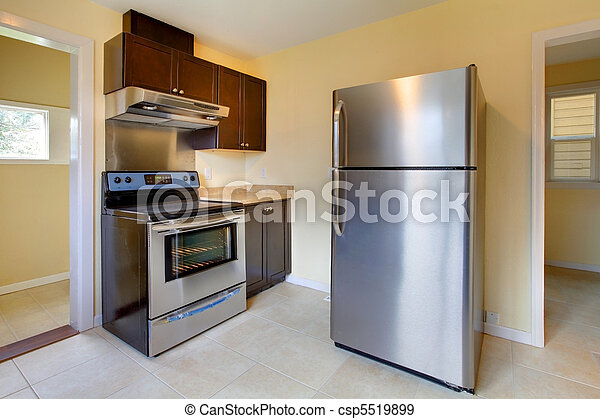 New modern kitchen with stove and refrigerator - csp5519899