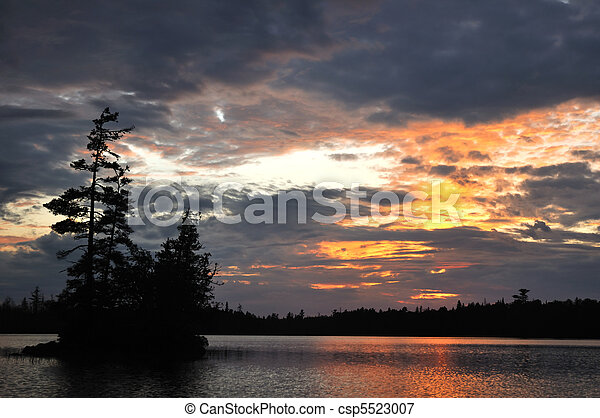 Scenic Island on a Remote Wilderness Lake at Sunset - csp5523007