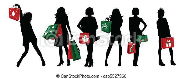 christmas silhouette girls shopping - csp5527360