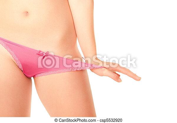 Young woman pulling pink panties - csp5532920