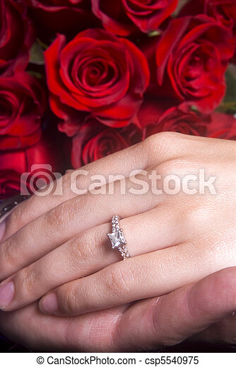 Husband and Wife hands showing Engagement ring - csp5540975