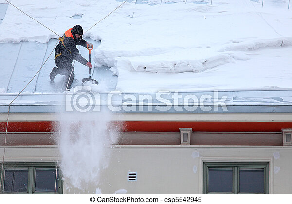 Man is de-icing a snowy Roof - csp5542945