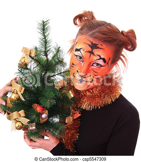 Girl in appearance a tiger with a new-year tree. - csp5547309