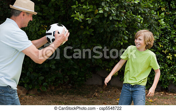 Grandfather and his grandson playing football - csp5548722