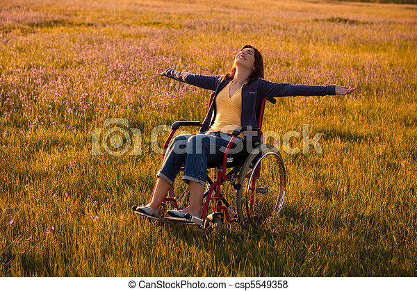 Handicapped woman on wheelchair - csp5549358