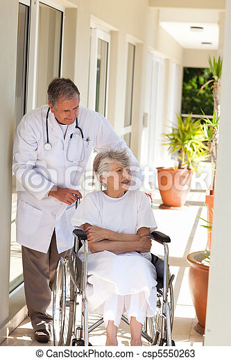 Senior doctor talking with his patient - csp5550263