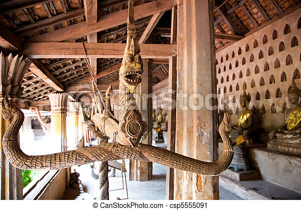 Buddhist mythical figure of Naga (magic dragon that lives in water), Wat Sisakorn, Laos - csp5555091