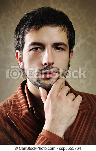 Young fashionable stylish man with a short beard posing - csp5555764