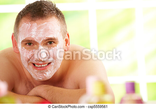 Man in spa with mask - csp5559561