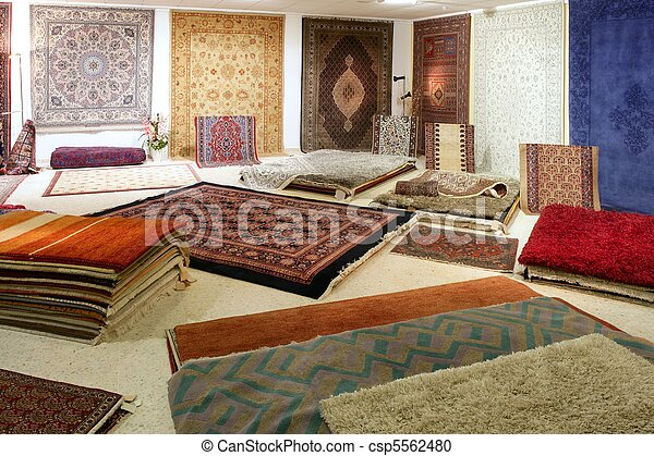 Arabic carpet shop exhibition colorful carpets - csp5562480
