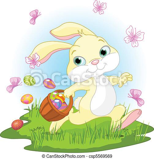 Easter Bunny Hiding Eggs - csp5569569