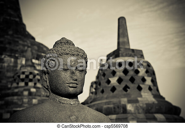 Buddha statue at Borobudur temple, Java, Indonesia - csp5569708