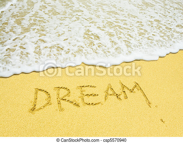 dream word written in the sandy beach - csp5570940
