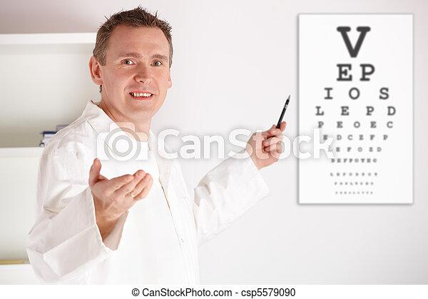Oculist doctor examining patient - csp5579090
