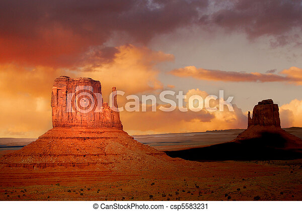 Twin peaks of rock formations in the Navajo Park of Monument Valley Utah - csp5583231