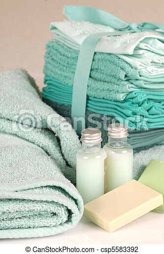Green towels with soap and shampoo - csp5583392