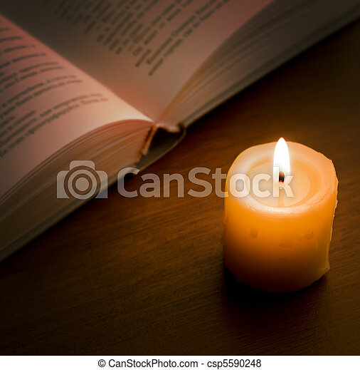 Book in candlelight - csp5590248