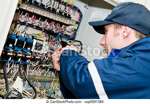 Electrician at voltage adjusting work - csp5591384