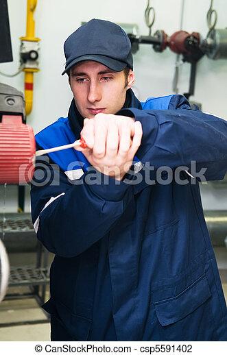 heating engineer in boiler room - csp5591402