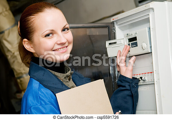 cheerful woman engineer in a boiler room - csp5591726