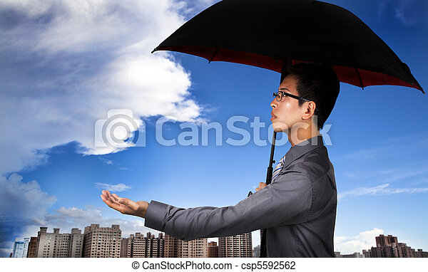 The insurance agent with umbrella and Weather Observation - csp5592562