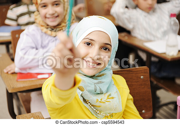 Adorable Muslim girl in classroom with her friends children students - csp5594543