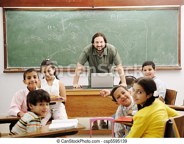 Teacher in classroom with his little happy students - csp5595139