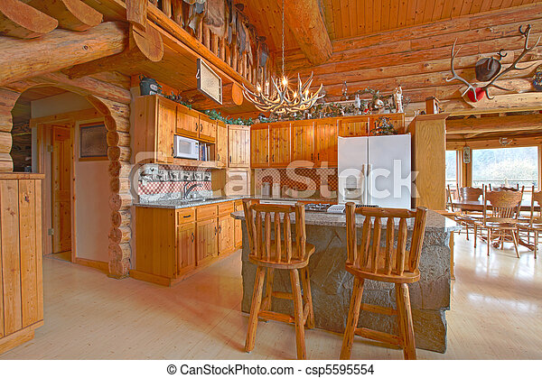 Beautiful kitchen in the rustic log cabin - csp5595554
