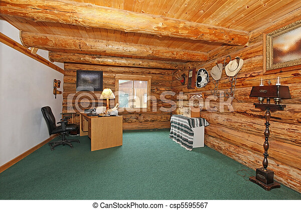 Log cabin office with green carpet and desk - csp5595567