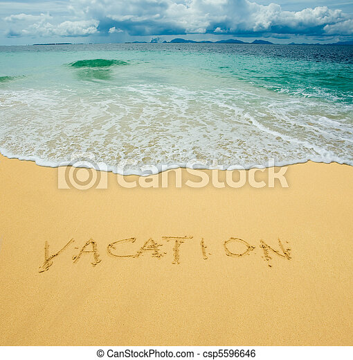 vacation written in a sandy tropical beach - csp5596646