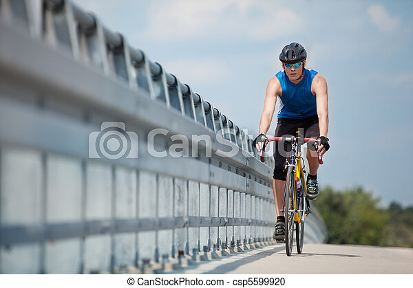 Biker riding on race  road bike - csp5599920