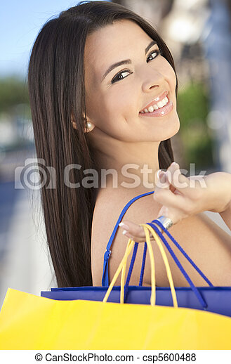 Beautiful Happy Hispanic Woman WIth Shopping Bags - csp5600488